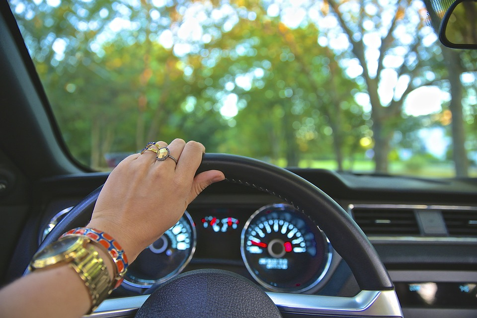 a woman holding steering wheel