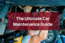 guide to car maintenance: car mechanic looking at a vehicle