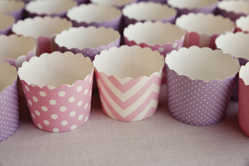 empty cupcake holders in pink and purple designs