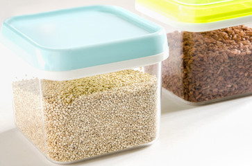 Food storage. Food ingredients (quinoa and brown rice) in plastic containers
