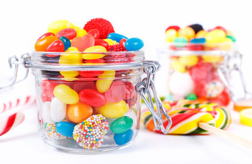 different colorful candy, sweetmeats and chewing gum in a container