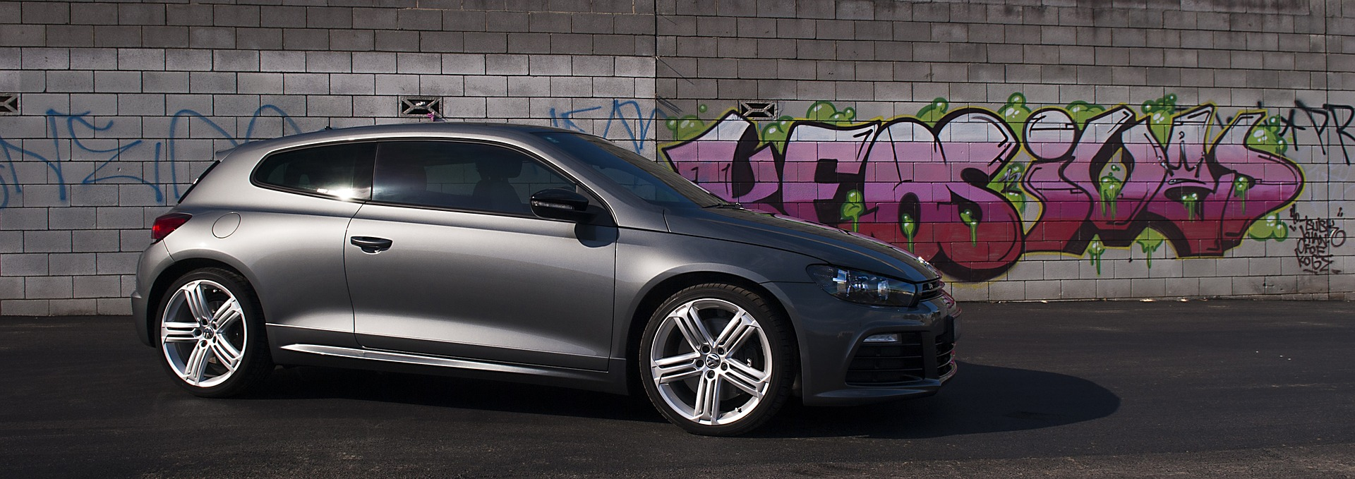 Volkswagen Scirocco against a graffiti background