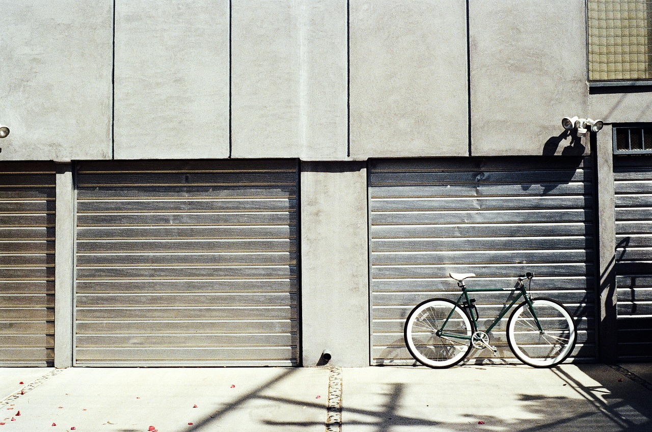 bike parked beside garage with metal doors