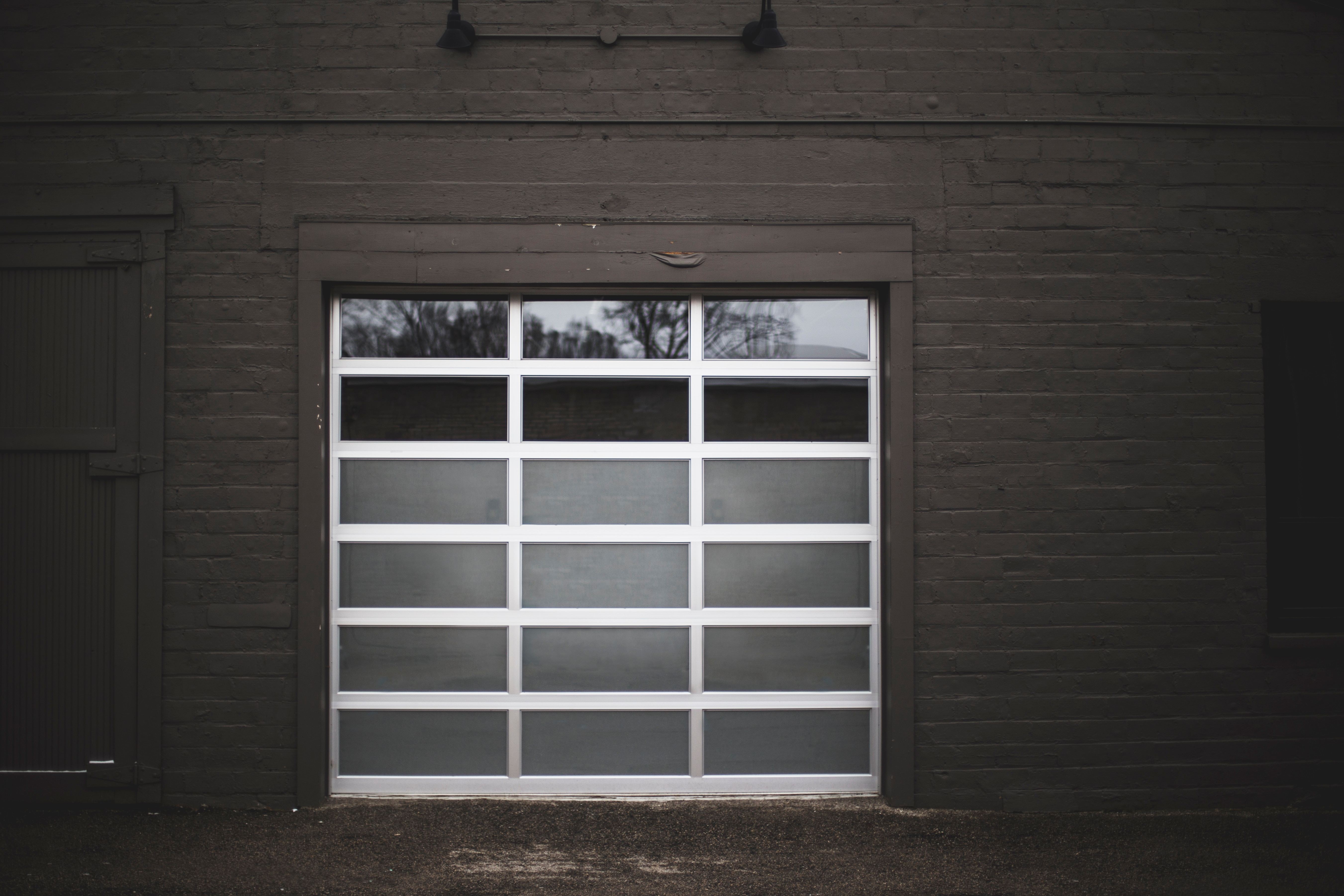 front view of garage with glass gate